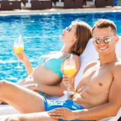 Young couple active leisure swimming pool at Villa del Arco Cabo