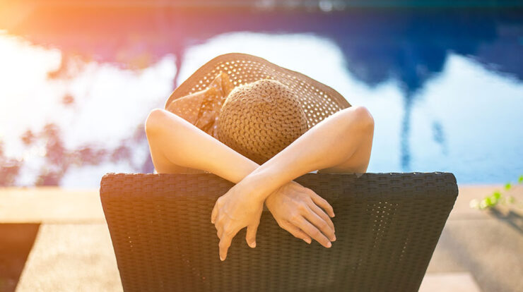 Woman relaxing on a pool day
